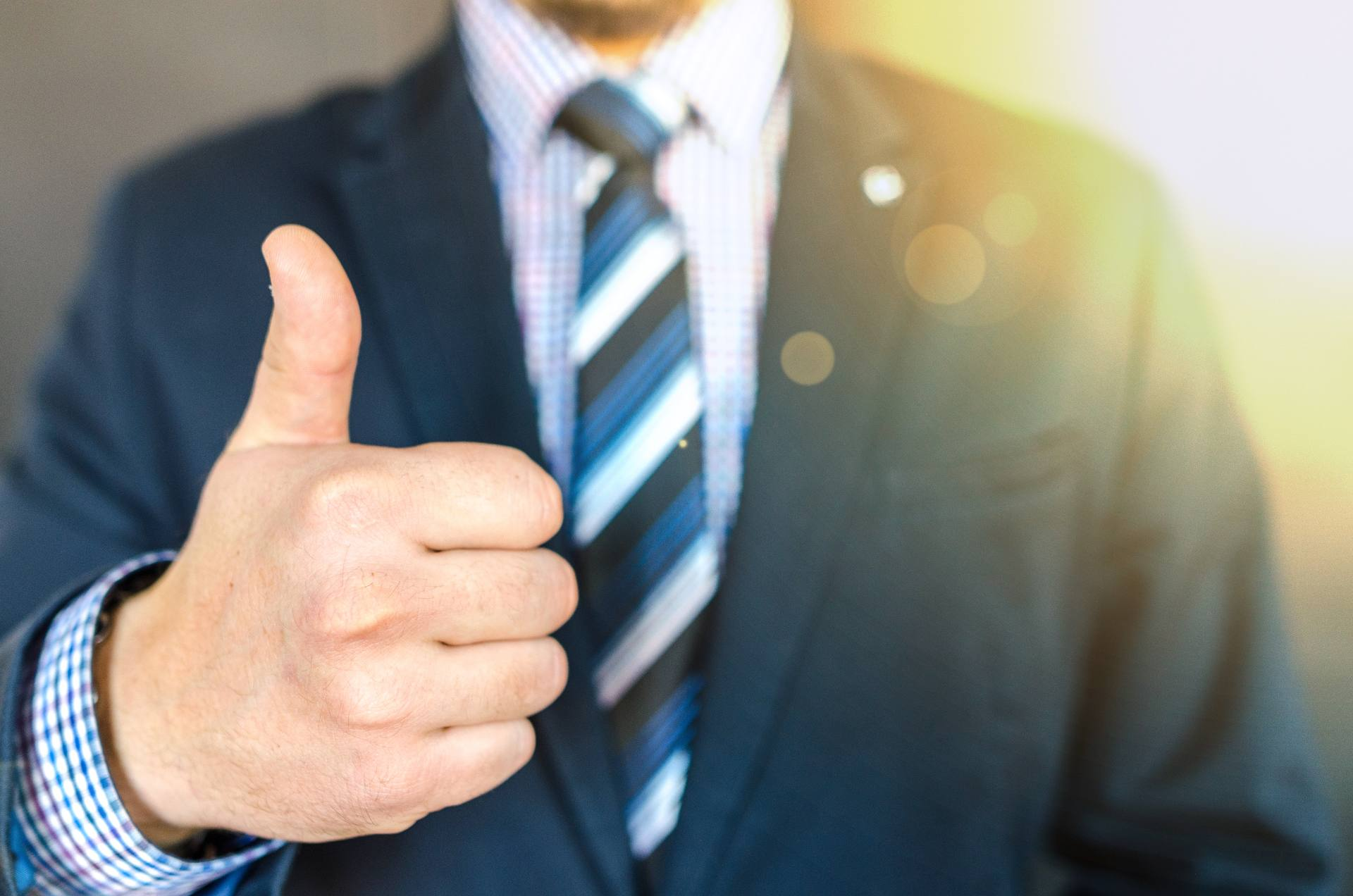 close-up-photo-of-man-wearing-black-suit-jacket-doing-thumbs-684385-1