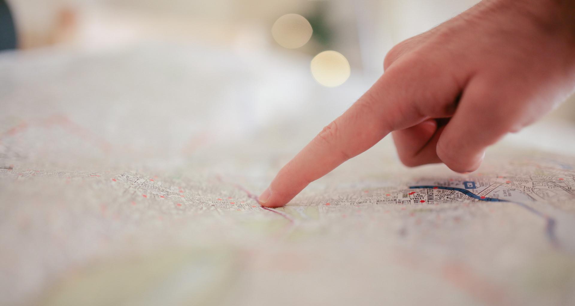 person-pointing-on-white-textile-34753-1
